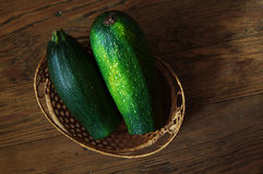Zucchini in a basket on table Royalty Free Stock Photo