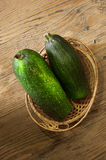 Zucchini in a basket on table Royalty Free Stock Photos