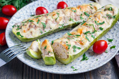 Zucchini boats stuffed with ground meet on a plate, horizontal Royalty Free Stock Photo