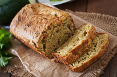 Zucchini bread with cheese. On a wooden background Royalty Free Stock Image