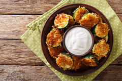 Zucchini in breading Panko with sour cream close-up on the table Stock Photo