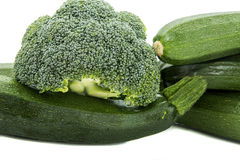 Zucchini, broccoli. Green zucchini and broccoli, white background, isolated Royalty Free Stock Photo