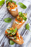 Zucchini,carrot and cheese bruschetta Royalty Free Stock Photos