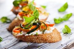 Zucchini,carrot and cheese bruschetta Royalty Free Stock Photo
