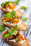 Zucchini,carrot and cheese bruschetta Royalty Free Stock Image