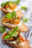 Zucchini,carrot and cheese bruschetta Royalty Free Stock Image