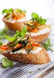 Zucchini,carrot and cheese bruschetta Stock Image