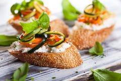 Zucchini,carrot and cheese bruschetta Stock Images