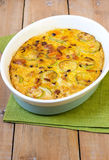 Zucchini and carrot gratin served Stock Photo