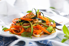 Zucchini and carrot salad. With spicy dressing Royalty Free Stock Photography