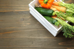 Zucchini and carrot in a white wooden container Stock Image
