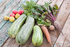 Zucchini, carrots, beets, apples and pears on a wo. Harvest of zucchini, carrots, beets, apples and pears on a wooden table background Royalty Free Stock Image