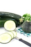 Zucchini on a checkered napkin. On a light background Royalty Free Stock Photo