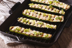 Zucchini with cheese on a grill pan close-up. horizontal Royalty Free Stock Photo