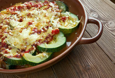 Zucchini with cheese and tomatoes Stock Photos