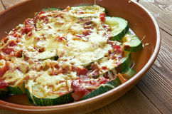 Zucchini with cheese and tomatoes Stock Image
