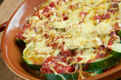 Zucchini with cheese and tomatoes Stock Photography