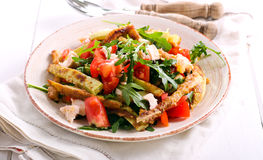 Zucchini, chicken, tomato and rocket salad Royalty Free Stock Photography