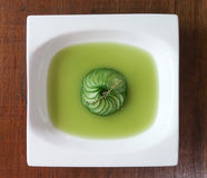 Zucchini consomme from above. Zucchini consomme in white bowl from above Royalty Free Stock Photography