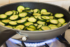 Zucchini while cooking Royalty Free Stock Photography