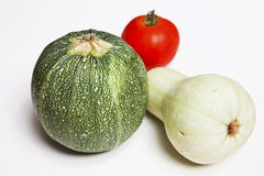 Zucchini-Courgette, pumpkin and a tomato. Isolated Royalty Free Stock Photos
