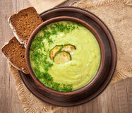 Zucchini cream soup. In a ceramic bowl stock images