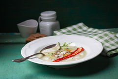 Zucchini cream soup with red pepper, cream, spices and balsamic cream Stock Photo