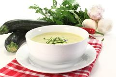 Zucchini creme soup. A bowl of zucchini creme soup with fresh julienne stock image