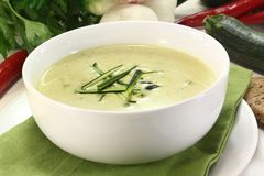 Zucchini creme soup. A bowl of zucchini creme soup with fresh julienne royalty free stock photos