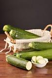 Zucchini (Cucurbita pepo). Closeup of a sliced zucchini  over a wooden table Stock Image