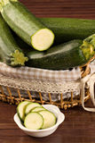 Zucchini (Cucurbita pepo). Closeup of a sliced zucchini  over a wooden table Royalty Free Stock Image