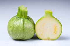 Zucchini. Cut into half on white background Stock Photos