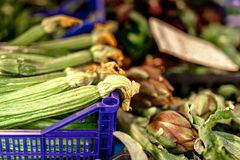 Zucchini flower blossoms in a crate at an Italian farmers market stock photos