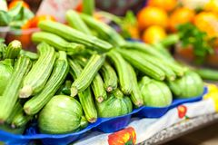 Zucchini flower blossoms in a crate at an Italian farmers market royalty free stock image