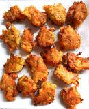 Zucchini flower fritters. Traditional Italian fritters made from zucchini flowers, parmesan and flour royalty free stock image