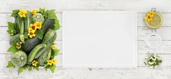 Zucchini, flowers and green sauce food top view, isolated on woo stock image