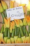 Zucchini. Fresh zucchini with flowers at the vegetable market. Milano, Italy Stock Photo