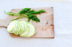 Zucchini. Fresh Sliced zucchini  and dill on wooden cutting board Royalty Free Stock Photos