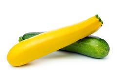 Zucchini. Fresh yellow and green zucchini on white background stock photography