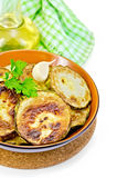 Zucchini fried in a ceramic bowl with a napkin Royalty Free Stock Images