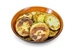 Zucchini fried in ceramic ware Stock Image