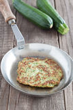 Zucchini fritter. In a pan Royalty Free Stock Images