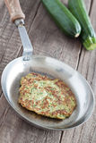 Zucchini fritter. In a pan Royalty Free Stock Photos