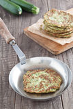 Zucchini fritter. In a pan Stock Photo