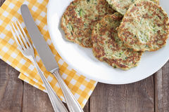Zucchini fritter. Served on a plate Royalty Free Stock Photo