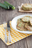 Zucchini fritter. Served on a plate Stock Photography