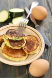 Zucchini fritters and fork. Stock Image