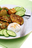 Zucchini fritters,garnish and sour cream sauce. Stock Images