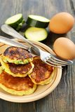 Zucchini fritters - a healthy and tasty breakfast. Stock Photos