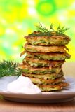 Zucchini fritters with sour cream. royalty free stock images